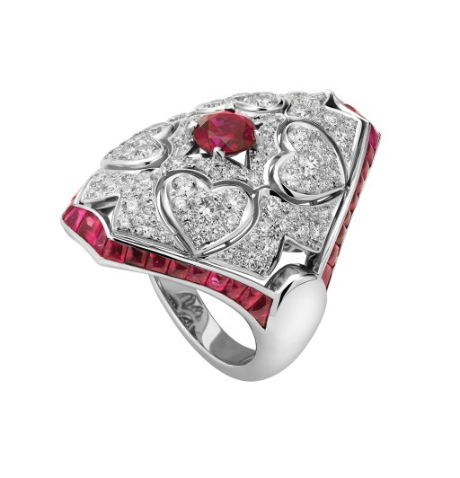 High Jewellery ring in white gold with 1 round ruby (0.9 ct), cabochon rubies, and pavé diamonds (1.42 ct).