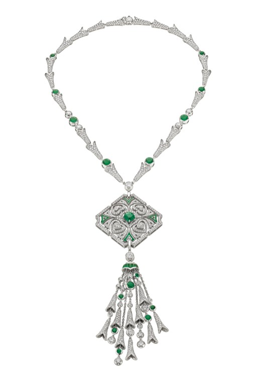 SPARKLING HEARTS high jewellery necklace in white gold (convertible in brooch) with 1 cushion shaped Colombian emerald (1.91 ct), 15 round shaped emeralds (6.51 ct), fancy buff-top emeralds (2.40 ct), round brilliant cut diamonds and pavé diamonds (23.40 ct).