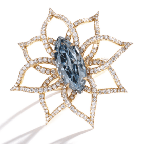 The marquise-shaped diamond of fancy vivid blue color weighing 3.18 carats, within an openwork mounting designed as a flowerset throughout with small round near colorless diamonds, mounted in 18 karat pink gold.