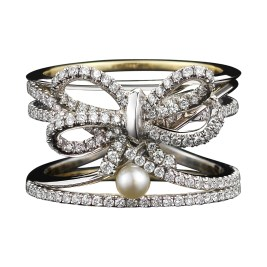 A contemporary Diamond Bow and Pearl ring set with Alexandra Mor signature details of 1mm knife-edged wire and 1mm 'floating' Diamond melee weighing a total of 1.13 carats. Platinum set around inner bands of 18-karat yellow gold. Signed by artist. Crafted in the USA. Limited-Edition 1/15