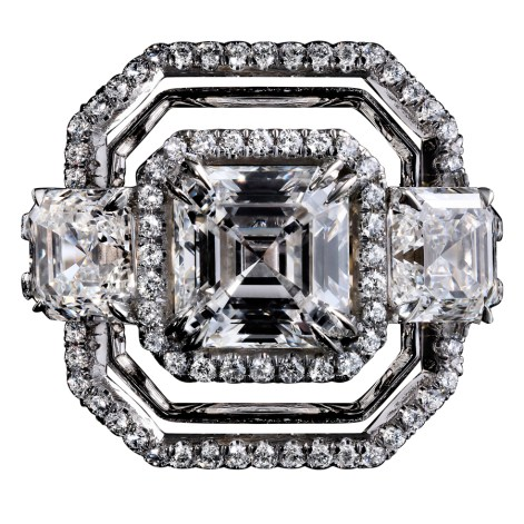 A three-stone Diamond ring comprised of an Asscher-cut Diamond of 2.10 carats, flanked by a pair of matching Ass- cher-cut Diamonds totaling 2.02 carats. Surrounded by an octagon of 1mm melee with a double band of 1mm 'floating' Diamond melee wires. Platinum set around a band of 1mm 18-karat yellow gold. Artist's print. Signed by artist. Crafted in the USA. Limited-Edition 1/5.