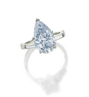 Simply setwith apear-shaped diamond of fancy blue colour weighing approximately 3.60 carats, flanked by baguette diamonds, mounted in 14 karat white gold.
