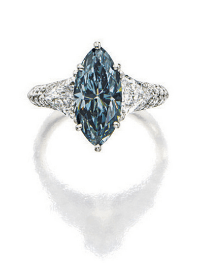 Set with a marquise-shaped fancy dark grey-blue diamond weighing 3.19 carats, flanked by two trilliant diamonds, further embellished with brilliant-cut diamonds, the diamonds together weighing approximately 1.80 carats, mounted in platinum.