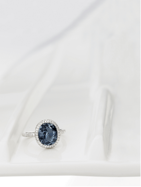 Set with an ovalfancy deep blue diamond weighing 2.01 carats, amid a bombé frame pavé-set with brilliant-cut diamonds extending to the shank, mounted in platinum.