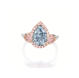 Centring on a pear-shaped fancy intense blue diamond weighing 2.06 carats, flanked by a pear-shaped fancy pink and fancy purplish pink diamond weighing 0.21 and 0.20 carat respectively,framed by circular-cut pink diamonds, to shoulders set with brilliant-cut diamonds, mounted in platinum and 14 karat pink gold.