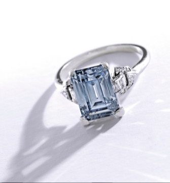 Centering an emerald-cut Fancy Grayish Blue diamond weighing 3.02 carats, the mounting accented by baguette, single, old mine and triangle-cut diamonds weighing approximately .30 carat, circa 1930.