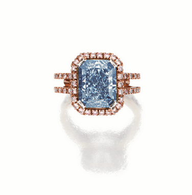 The radiant-cut fancy intense blue diamond weighing 5.02 carats, set within a border of circular-cut pink diamonds, similarlyaccented to the shoulders, mounted in 18 karat pink and white gold.