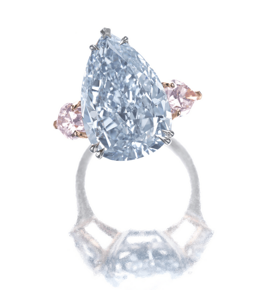 Set with a fancy intense blue pear modified brilliant-cut diamond weighing 10.09 carats, between similarly cut fancy light pink diamonds weighing 1.02 and 1.00 carats respectively, mounted in platinum and pink gold.
