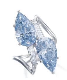 Of toi et moi design, set with two pear-shaped diamonds, one fancy vivid blue weighing 3.08 carats, the other fancy intense blue weighing 2.83 carats, between tapered baguette diamonds.