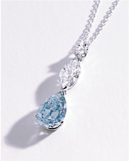 The pendant set with a pear-shaped diamond of fancy intense blue color weighing 2.59 carats, surmounted by a marquise-shaped diamond weighing .92 carat, and a round diamond approximately .10 carat, completed by a platinum, link chain.