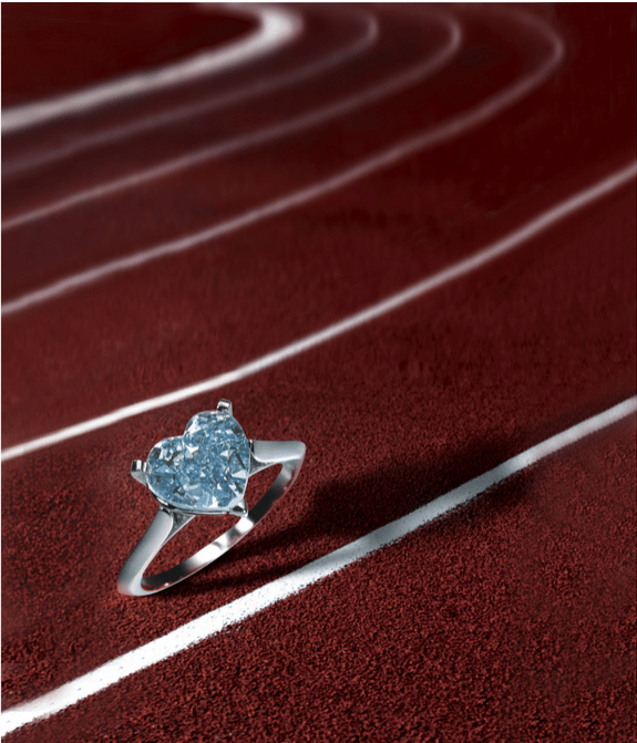 Set with a heart-shaped fancy vivid blue diamond weighing 3.47 carats,mounted in platinum.