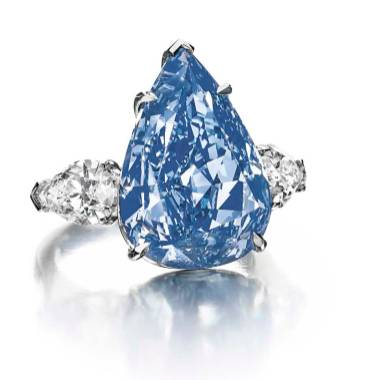 'The Blue' diamond, a 13.22ct Fancy Vivid blue pear-shaped diamond, is the largest flawless Fancy Vivid blue diamond in the world. It has been renamed 'The Winston Blue' by its new owner, Harry Winston. 'The Winston Blue' diamond set a new world auction record for the price per carat for a blue diamond at Christie's Geneva. The star at Christie's sale of Magnificent Jewels in Geneva on 14 May 2014 was the 13.22ct 'The Blue' diamond. It sold for close to $23.8 million, which is nearly $1,800 per carat - a new world record price per carat for a blue diamond.
