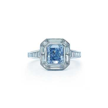 The intricate custom-designed setting for this exquisite Fancy Intense Blue diamond highlights the gem's unparalleled beauty. Ring in platinum with a rectangular modified brilliant blue diamond framed by 26 curved baguette white diamonds. Blue diamond, carat weight 1.59; white diamonds, carat total weight 1.38