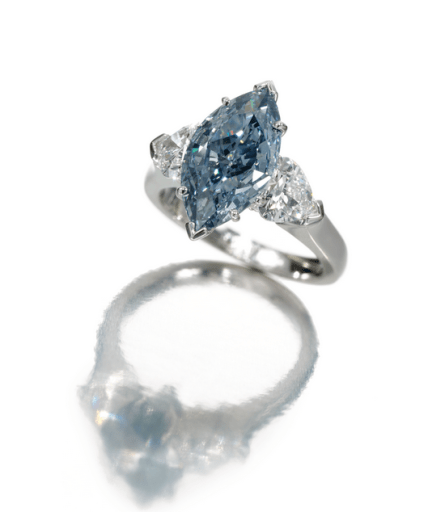 Set at the centre with a fancy deep blue marquise-shapeddiamond weighing 2.07 carats, between heart-shaped diamond shoulders.