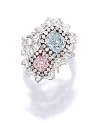 Set with a cushion-shaped Fancy Light Purplish Pink diamond weighing 1.00 carat anda cushion-shaped Very Light Blue diamond weighing 2.01 carats, decorated by variously-shaped diamonds together weighing approximately 1.40 carats, mounted in 18 karat white and pink gold.