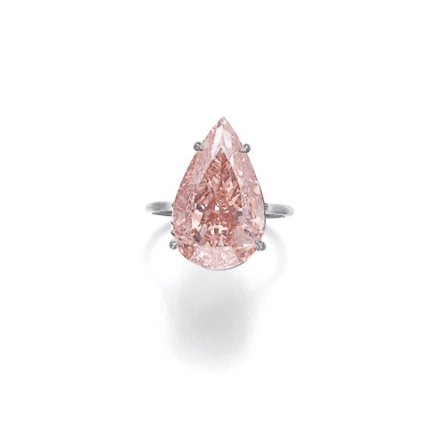 Attractive fancy brownish orangy pink diamond ring. Estimate: $971,675 - 1,455,021