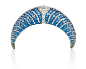 A Belle Epoque enamel and diamond tiara, by Chaumet. Of Kokoshnik design, composed of a series of graduated translucent royal blue plique-à-jour enamel curved panels, each overlaid with old-cut diamond trailing forget-me-not floral motifs, interspersed with collet-set diamond lines, to the cushion-shaped diamond openwork cartouche centre and similarly-set upper border, circa 1910, mounted in platinum and gold, with a later fitted case. Estimate: US$380,000-550,000.