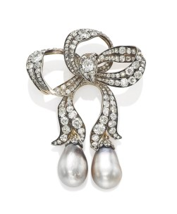 19th century brooch which combines outstanding craftsmanship, beautiful old cut diamonds and exceptional natural pearl drops. Estimate: US$816,500 - $1,020,625.