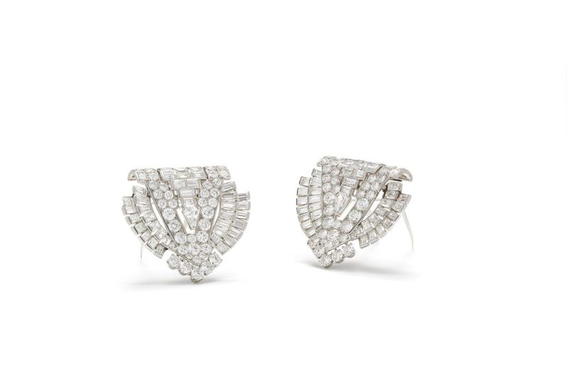A pair of Art Deco diamond clip brooches by Cartier lot 174