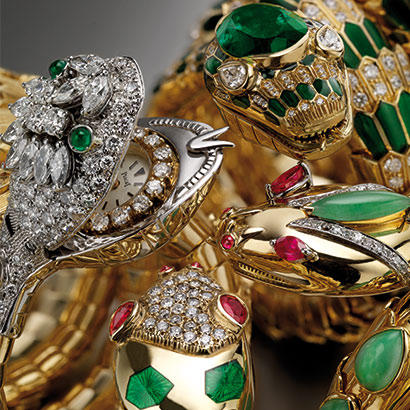 Snake bracelet watches in gold with green enamel rubies and diamonds circa 1975