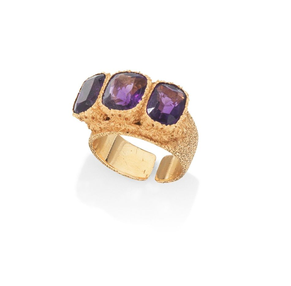 A gold and amethyst three-stone ring, by Buccellati