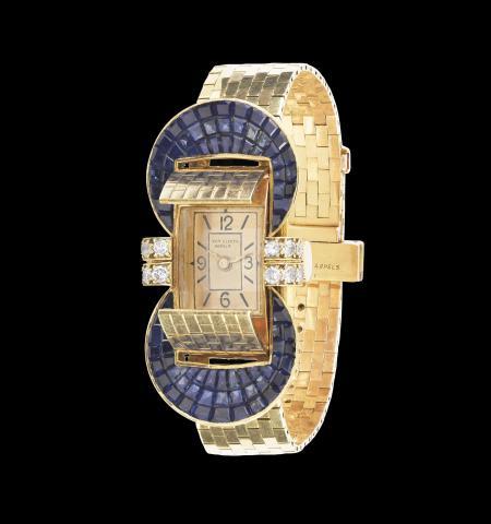 반 클리프 아펠. 플랩이있는 루도 손목 시계