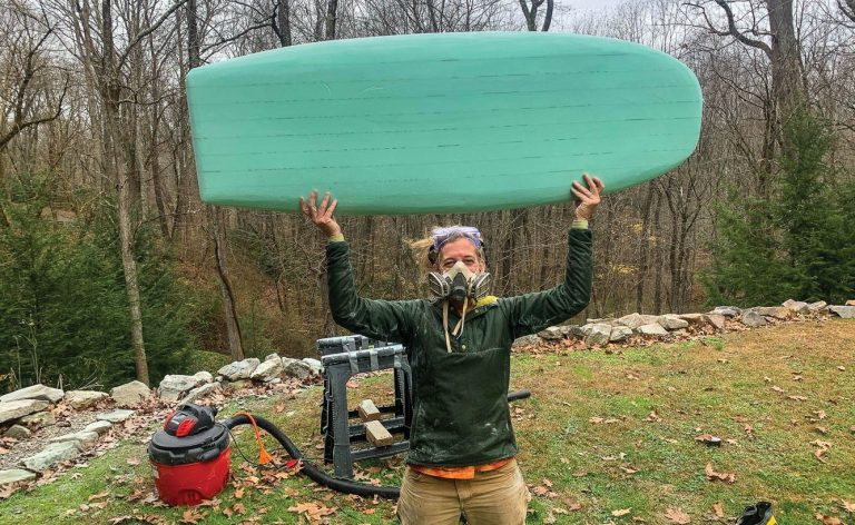 River surfboard: Holding up the shaped board