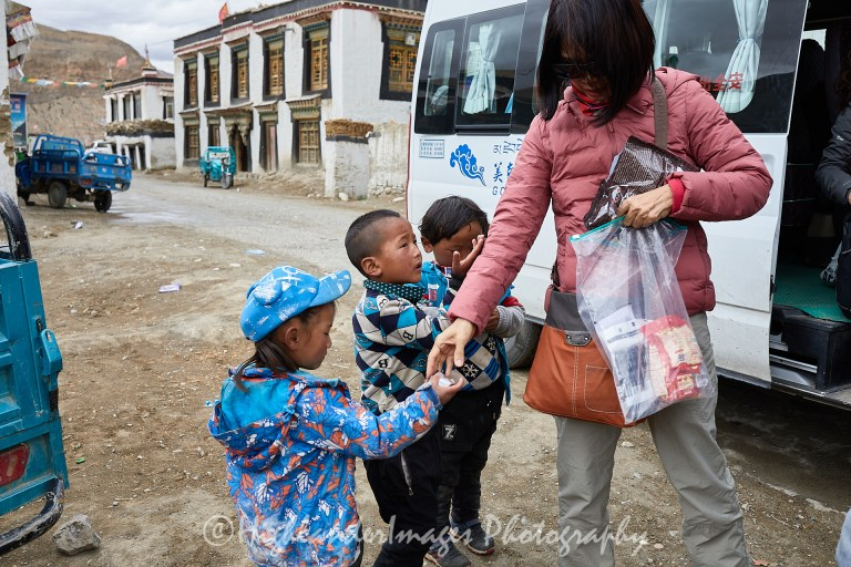 Donating to poor children in Zhabu village in Qomolangma National Nature Reserve, Tibet