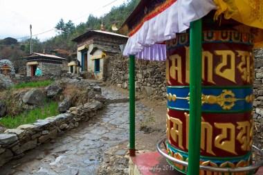 Prayer wheel between Koshigaun village and Phakding
