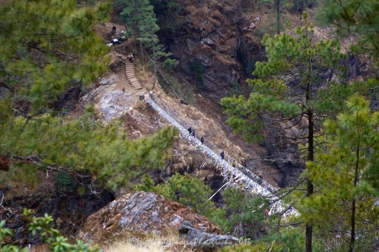 The suspension bridge over the river at the bottom of the steep track from Namche Bazaar on the route towards Phakding.