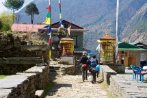 Passing two prayer wheels on the trail between Monjo and Lukla.