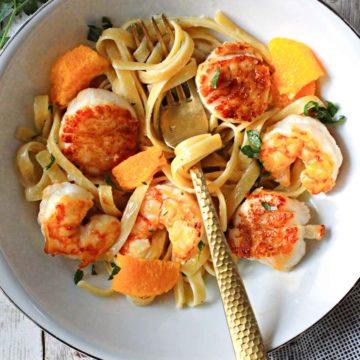 seared shrimp and scallops over fettuccini pasta with orange cream sauce