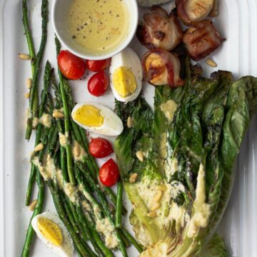 Grilled Romaine Salad with pine nut dressing, grilled asparagus and bacon wrapped scallops