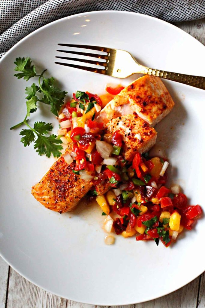 Salmon fillet topped with chipotle peach salsa