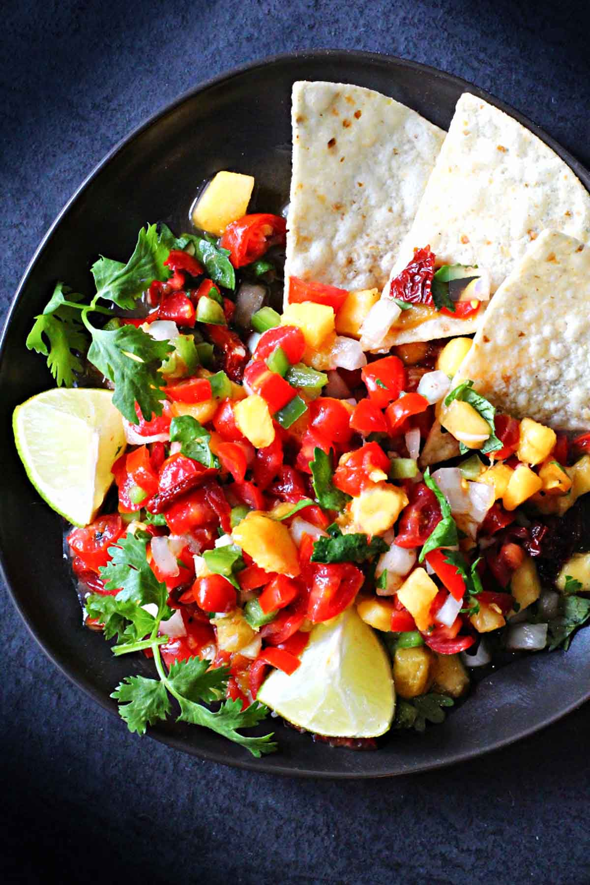 spicy peach salsa recipe served with tortilla chips