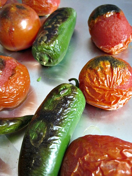 Roasted chile peppers and tomatoes for Chicken Enchiladas with Tomato Cream Sauce