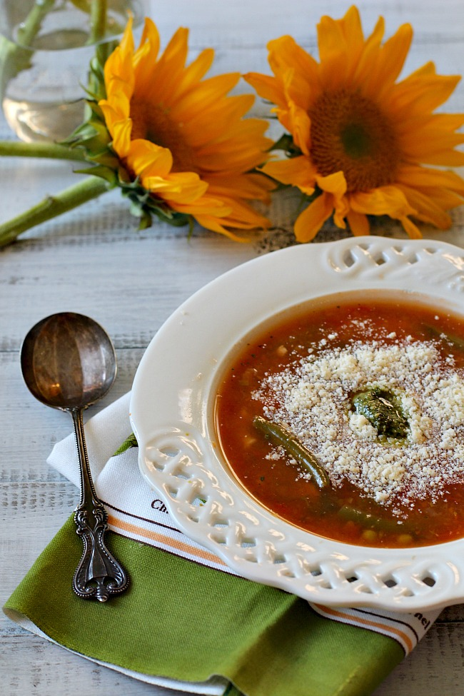 Nick's Italian Cafe famous Minestrone Soup Recipe topped with parmesan cheese and fresh pesto