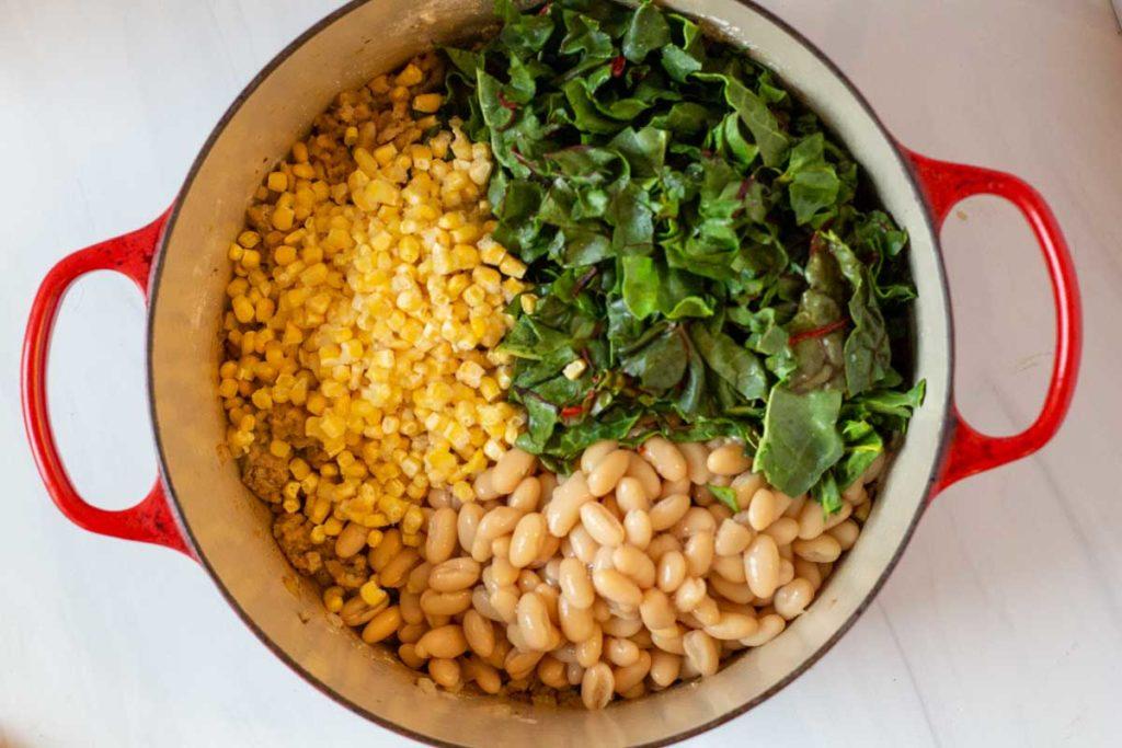 adding corn, swiss chard and white beans to chili