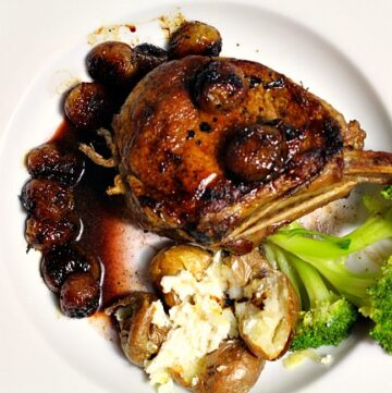 Seared and Pan roasted Veal Chops with red grapes. Perfect meal for New Year's Eve