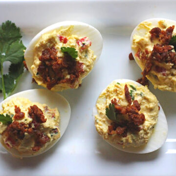 Chorizo Mexican Deviled Eggs topped with cilantro