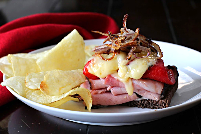 Ham and Manchego cheese sandwich with roasted red bell peppers and caramelized onions