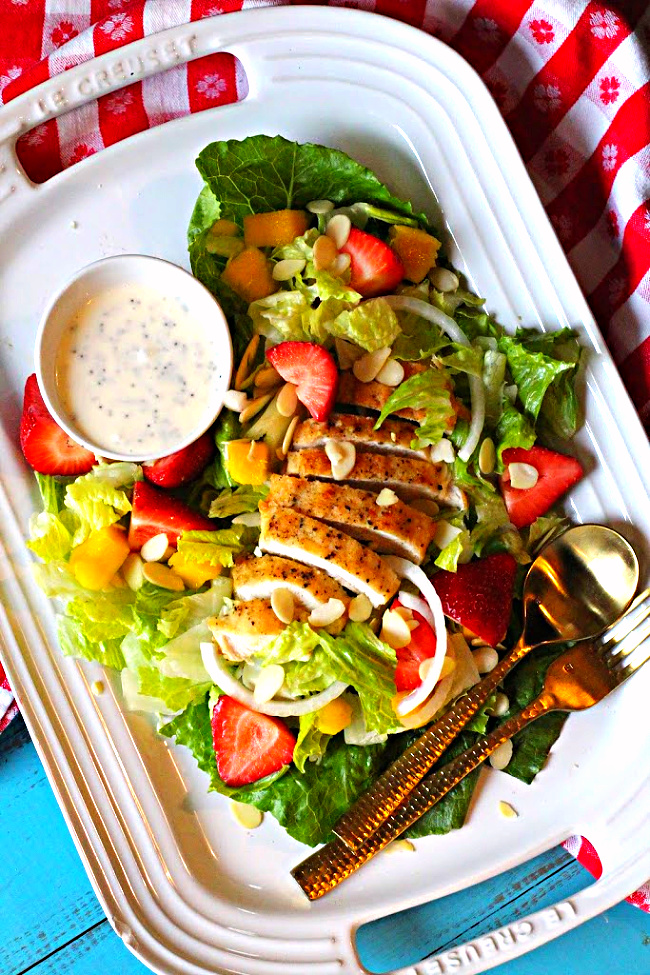 Fried chicken salad with strawberries, mango and creamy poppyseed dressing