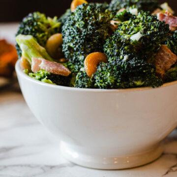 Broccoli salad with bacon, cashews sugar vinegar and mayonnaise