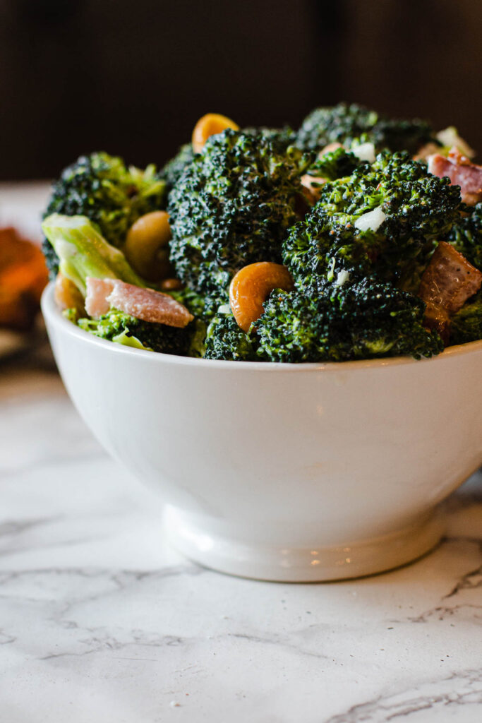 Broccoli salad with bacon, cashews sugar vinegar and mayonnaise