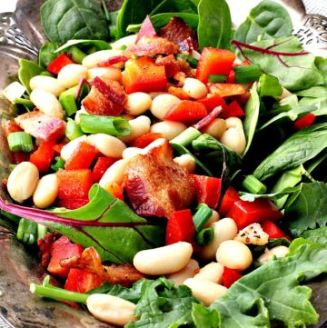 bacon, white bean, spinach salad recipe. With maple vinaigrette served on a silver platter
