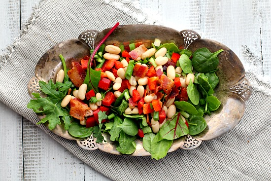 Spinach, white bean, bacon salad with Maple Syrup Vinaigrette. A delicious crowd pleasing salad.