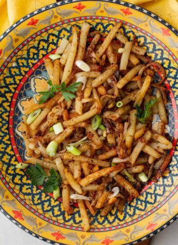 Turkish fries seasoned with aleppo pepper and served in a colorful bowl