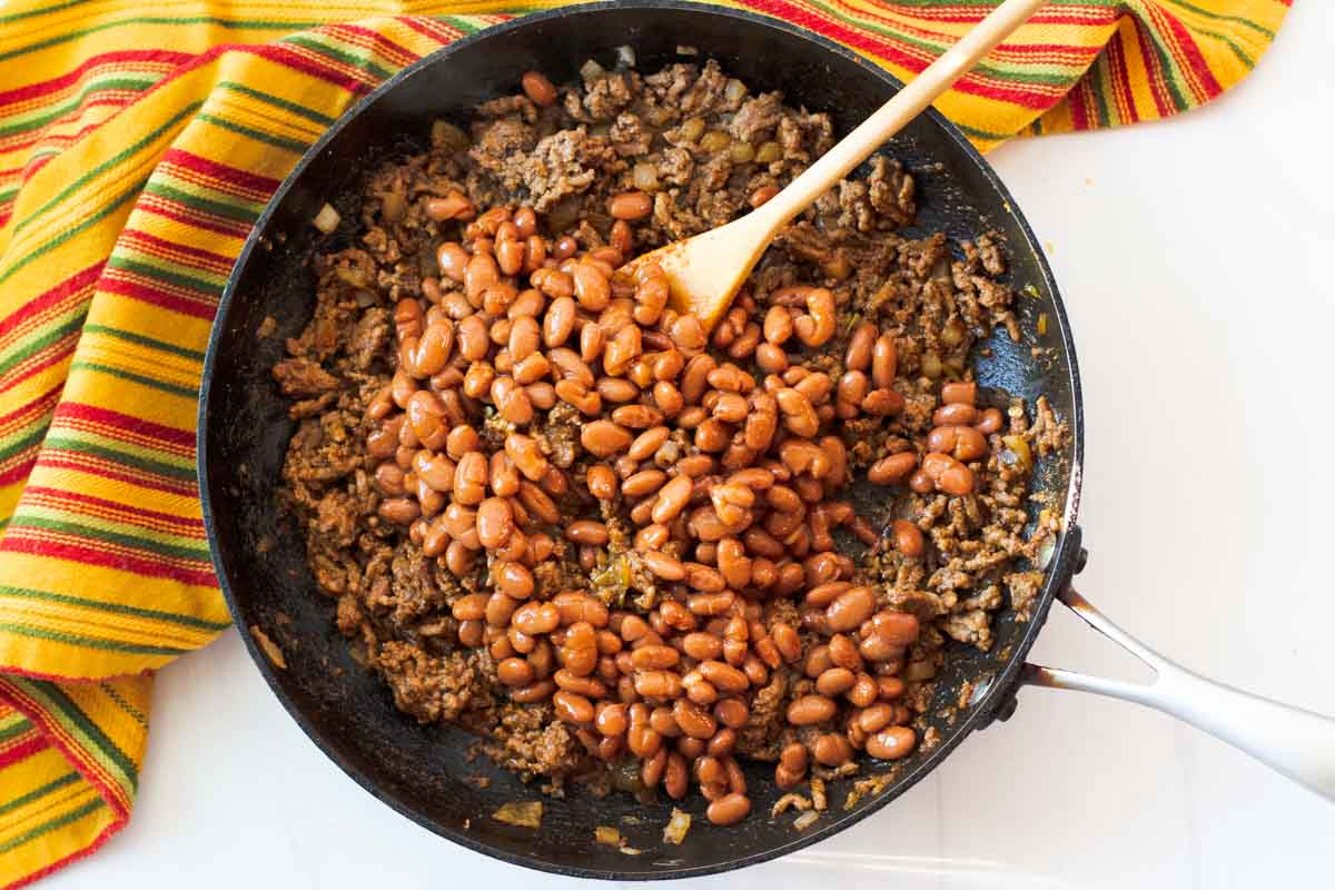 Adding beans in chile sauce to ground beef