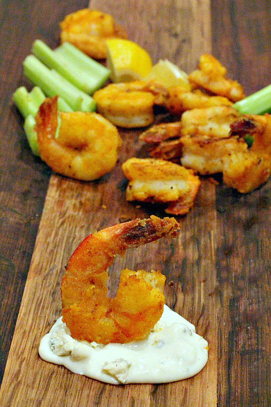 Breaded shrimp for buffalo shrimp appetizer served with blue cheese dressing