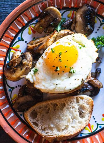 Sherried mushrooms with a fried egg served on rustic bread toast